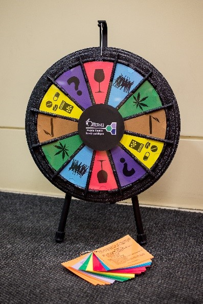 Photo of wheel with trivia questions on susbstance use