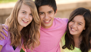 Photo of three youth smiling