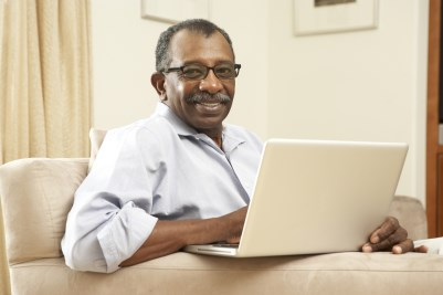 Man looking sitting with laptop