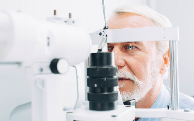 Man getting eye exam at clinic, close-up