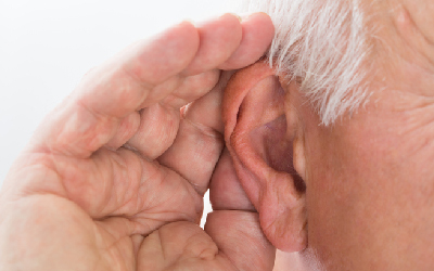 Close-up of a man trying to hear