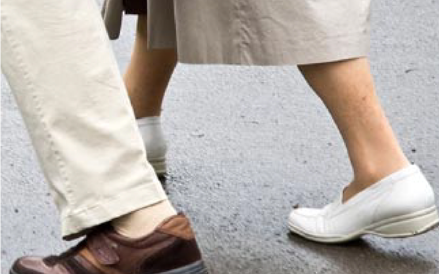Close-up of two people's feet walking