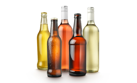 Image of alcohol bottles with no labels.