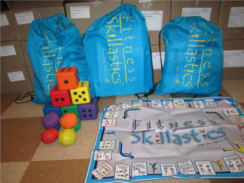 Image of fitness skillastic kit that includes a giant dice, balls, and a large board game-style mat