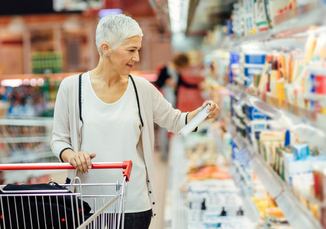 Older adult female buying groceries