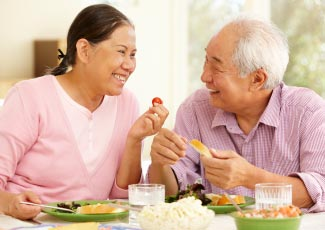 Older couple eating food together