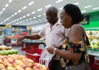 Older couple choosing fruits in a grocery store