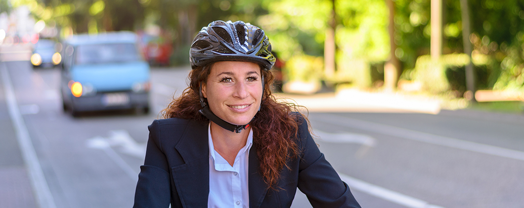 Women cycling with helmet on