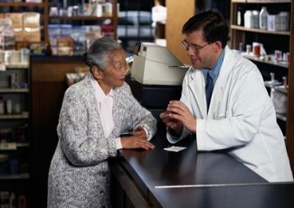 Pharmacist speaking to client about medications