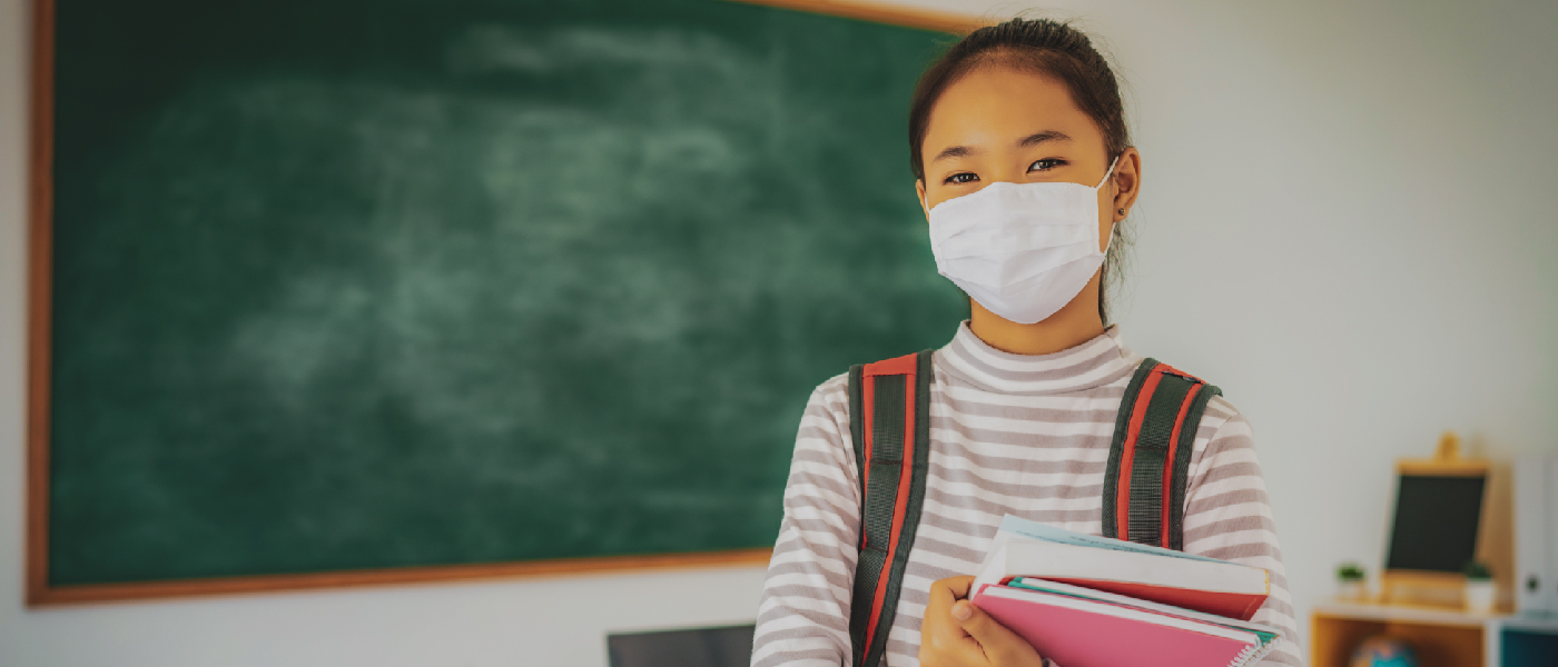 A girl wearing mask in school