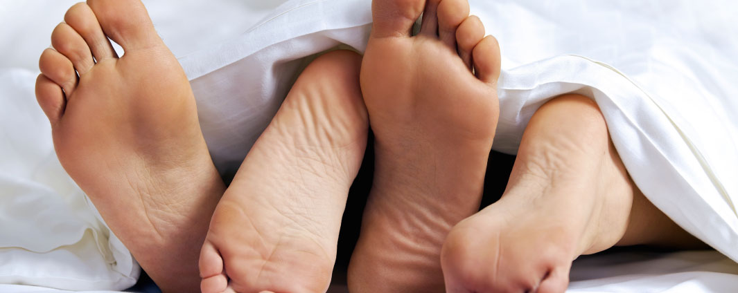 A pair of feet in a bed