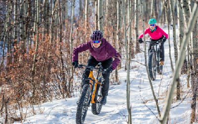 Two riders on mountains bikes in the winter