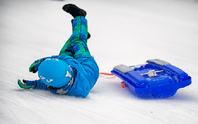 A child who has fallen from a toboggan